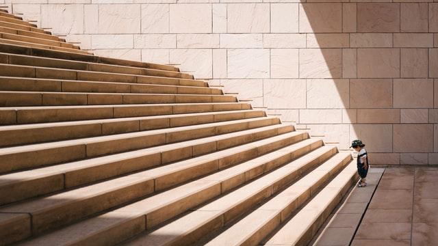 Child starring at large set of steps.