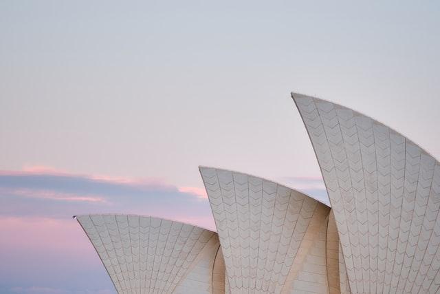 Sydney Opera House sails during sunset.
